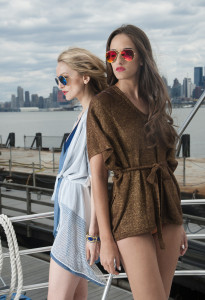 Jia Li Collection (Left) Arianna Cardigan with Blue Mirrored Ray Bans, (Right) Dominika Poncho with Gold Mirrored Ray Bans