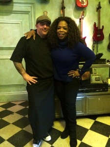 Chris Santos and Oprah Winfrey at the Beauty and Essex Pawn Shop