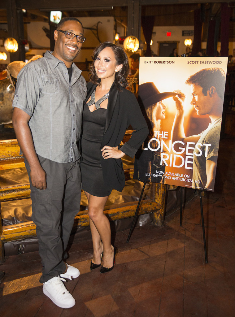 """George Tillman, Jr. and Cheryl Burke cowboy-up to celebrate the Digital HD, Blu-ray and DVD release of """"The Longest Ride"""" on Tuesday, July 14, 2015 at Saddle Ranch Chop House in Universal City, Calif. (Photo by Colin Young-Wolff/Invision for Twentieth Century Fox Home Entertainment/AP Images)"""