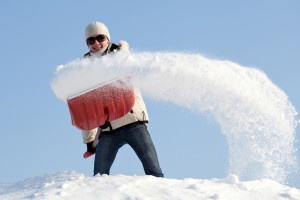 How to Avoid Injuring Your Back While Shoveling Snow