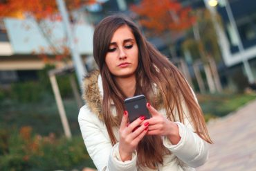 What are we avoiding while on our phones?